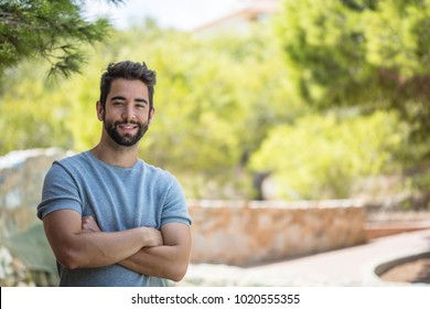 young man smiling at countryside
