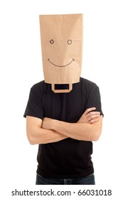 young man with smiling ecological paper bag on head and crossed arms