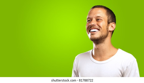young man smiling on a green background