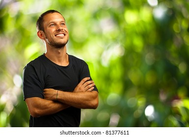 young man smiling in the park
