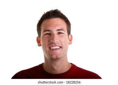 A young man smiling in a red shirt on a white background
