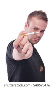 Young man smoking a cigarette isolated on white background