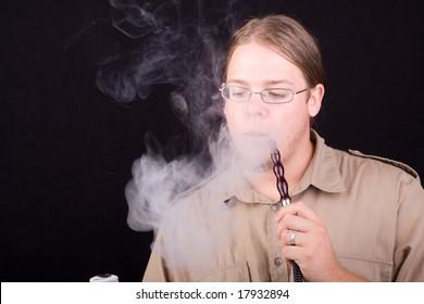 young man smoking water pipe