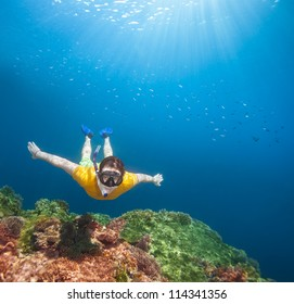 Young man snorkeling in Red Sea