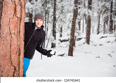 Young Man with a Snowball (Ready for Snowball Fight)