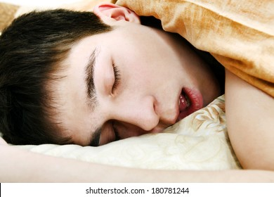 Young Man sound sleeping in the Bed close-up
