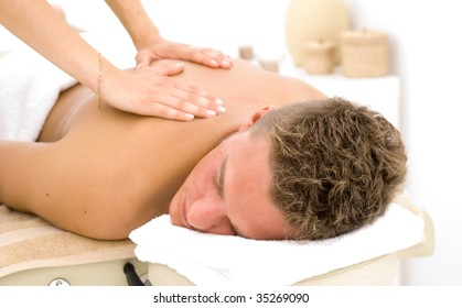 young man in a spa getting a massage