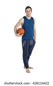 Young man in sport suit with a ball in full-length