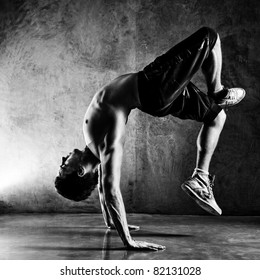 Young man sports exercises. Contrast black and white.