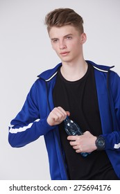 young man in sportswear with bottle of water