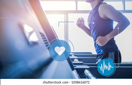 Young man in sportswear running on treadmill at gym healthy lifestyle. technology and lifestyle concept