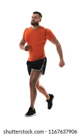 Young man in sportswear running on white background
