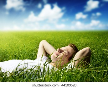 young man in spring grass