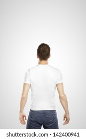young man standing back on a white background