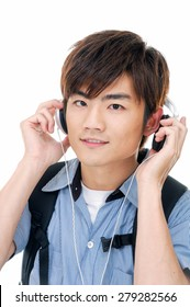 young man standing man with backpack with headphones.