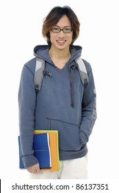 Young man standing with book and bag