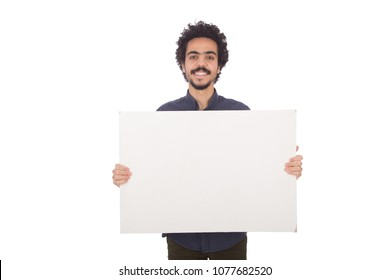 Young man standing and holding a white billboard in a Horizontal pose, isolated on a white background.