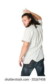 Young man standing leaning on a wall on white background
