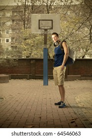Young man standing on a basketball court