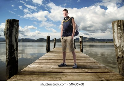 Young man standing on a dock