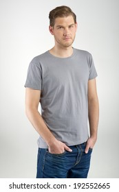 Young man standing on light background
