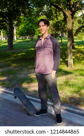 Young man standing on skateboard getting rest after skating. Teen boy skater
