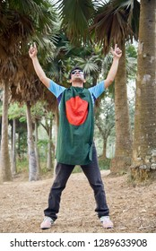 Young man standing in a place with a Bangladeshi national flag