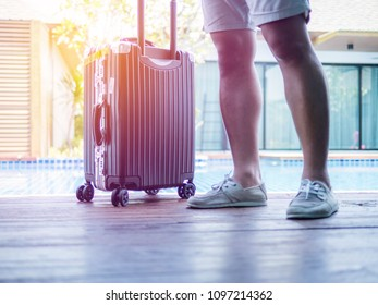 Young man Standing with Travel suitcase. Summer holiday traveling concept design banner with copyspace.