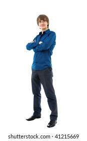 Young man standing. Wearing shirt and trousers. Isolated over white