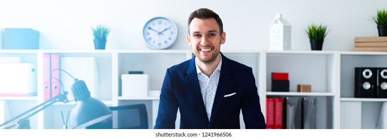 A young man stands in the office
