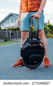 Young Man Stanging Near Electric Unicycle (EUC) Outside On a Street, Beautiful Summer Day, Best Mobile Portable Personal Transportation Vehicle -  Riga / Latvia - June 1st 2020