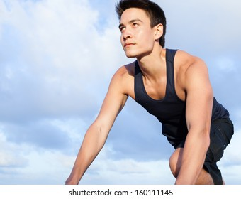 Young man starting to run