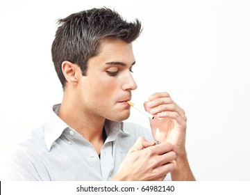 Young man starting smoking a cigarette