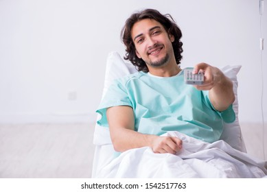 Young man staying in hospital in transfusion concept