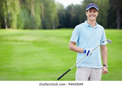 A young man with a stick on the golf course