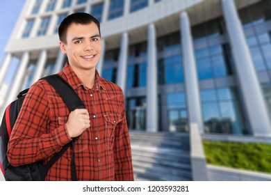 Young man student in red shirt