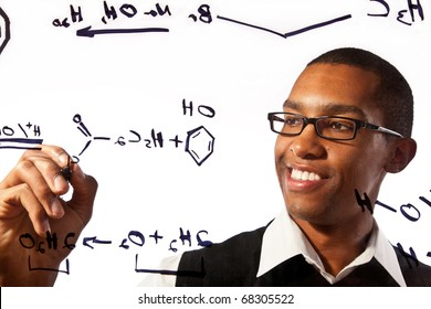 a young man studies a chemistry problem