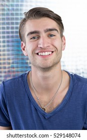 Young man in studio looking at camera