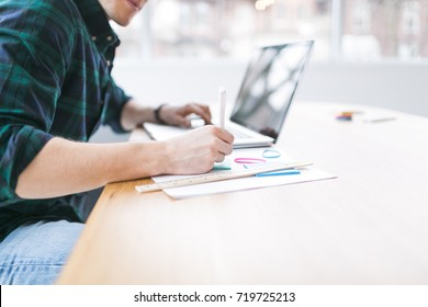 Young man studying with a laptop