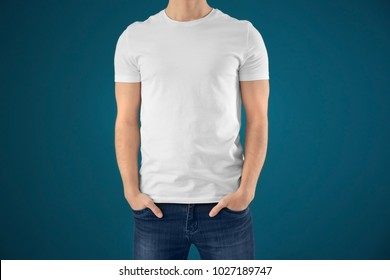 Young man in stylish t-shirt on color background. Mockup for design