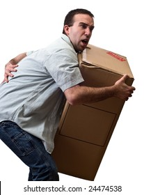 A young man suffering from back pain while lifting a large box, isolated against a white background