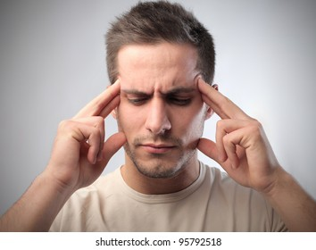 Young man suffering from headache