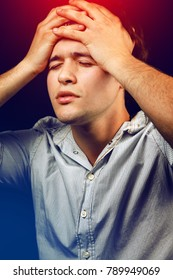 Young man suffering from headache and stress