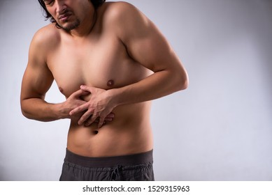 Young man suffering from stomachache