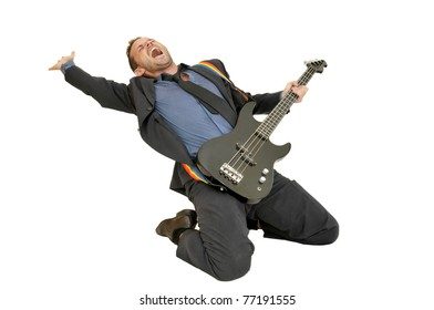 Young man in a suit with guitar