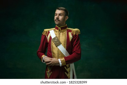 Young man in suit as Nicholas II isolated on dark green background. Retro style, comparison of eras concept. Beautiful male model like historical character, monarch, old-fashioned. - Shutterstock ID 1825328399