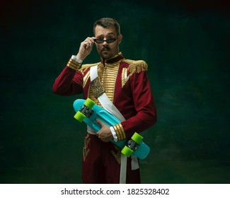 Young man in suit as Nicholas II isolated on dark green background. Retro style, comparison of eras concept. Beautiful male model like historical character, monarch, old-fashioned. - Shutterstock ID 1825328402