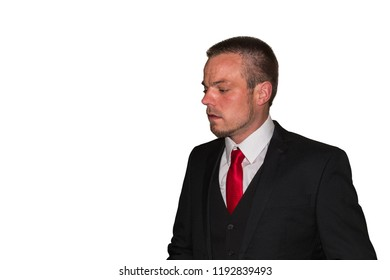 Young man in suit with red tie against white background, copy space.