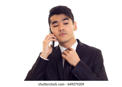 Young man in suit talking on the phone
