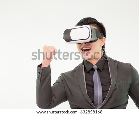 c3d4a09aefce Young man in suit uses a virtual reality glasses on white background,Man  using a